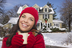 Smiling Woman in Winter Clothing Holding Mug Outside in Snow Royalty Free Stock Photos
