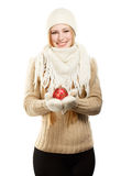 Smiling woman in winter clothing with red ball Stock Image