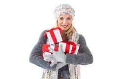 Smiling woman in winter fashion holding presents Stock Photos