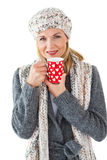 Smiling woman in winter fashion looking at camera with mug Stock Photo