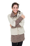 Smiling woman in winter fashion standing cross armed Royalty Free Stock Images
