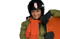 Smiling woman in winter outfit with snowboard Stock Images