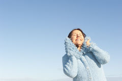 Smiling woman winter sky  Royalty Free Stock Image