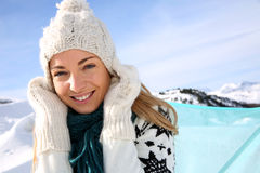 Smiling woman in winter vacation Royalty Free Stock Image