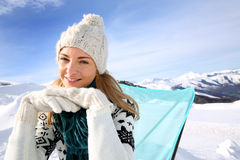 Smiling woman in winter vacation royalty free stock photography