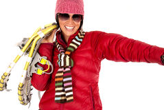 Smiling woman in winter wear carrying snow shoes Stock Images