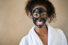 Free Smiling Woman With Charcoal Face Mud Royalty Free Stock Photography - 159265617
