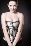 Smiling Woman With Cleavage In A Corset Stock Photo