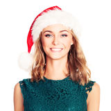Smiling Woman Woman in Santa Hat. Christmas Fashion Model. Isolated on White Stock Photography