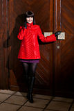 Smiling woman and wooden door Stock Images