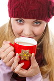 Smiling woman in woolen cap and shawl with gingerbread cookies and tea, white background, christmas time Stock Image