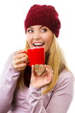 Smiling woman in woolen cap and shawl with gingerbread cookies and tea, white background, christmas time Stock Photography