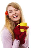 Smiling woman in woolen gloves with cup of tea wrapped scarf, autumn decoration Stock Photography