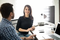 Smiling woman at work Stock Images