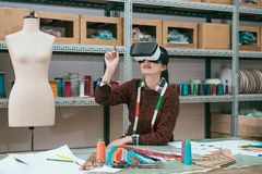 Smiling woman worker using virtual reality device Stock Image