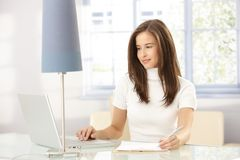Smiling woman working at home Royalty Free Stock Photography