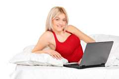 Smiling woman working on a laptop Stock Images