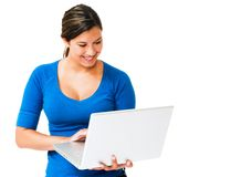Smiling woman working on laptop Royalty Free Stock Photos