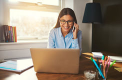 Smiling woman working at laptop. Like female entrepreneur at desk Royalty Free Stock Images