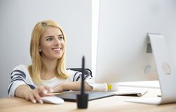 Smiling woman working in office. Smiling beautiful woman working in office Royalty Free Stock Photos
