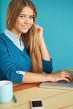 Smiling woman working in office Stock Image