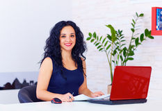 Smiling woman working in office Royalty Free Stock Image