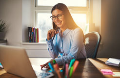 Smiling woman working at office Stock Image