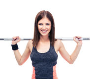 Smiling woman working out with barbell Royalty Free Stock Image