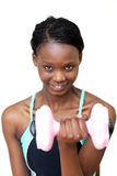 Smiling woman working out with dumbbell Royalty Free Stock Photo