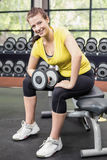 Smiling woman working out with dumbbells Stock Image