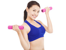 Smiling woman working out with dumbbells in her hands Royalty Free Stock Image