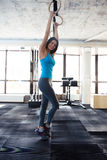 Smiling woman working out on gimnastic rings Stock Photography