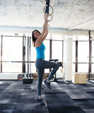 Smiling woman working out on gimnastic rings Royalty Free Stock Images