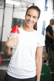 Smiling woman in workout outfit at fitness gym Stock Image
