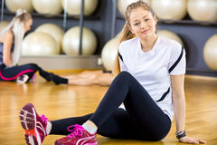 Smiling woman in workout outfit at the fitness gym Stock Image