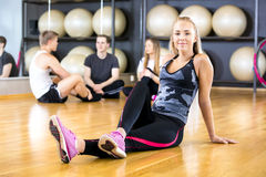 Smiling woman in workout outfit at the fitness gym Stock Photography