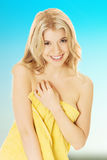 Smiling woman wrapped in towel Royalty Free Stock Photo