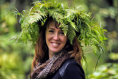 Smiling woman with a wreath of fern on the head stock photo