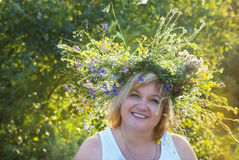 Smiling woman in wreath. Smiling ukrainian woman in wreath stock images