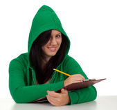 Smiling woman writing on clipboard Stock Photos