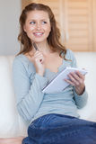 Smiling woman writing down notes Stock Image