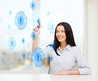 Smiling woman writing on virtual screen Stock Images