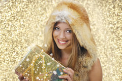 Smiling woman with xmas gifts Royalty Free Stock Photo