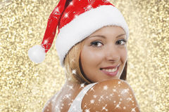 Smiling woman with xmas hat Royalty Free Stock Photos