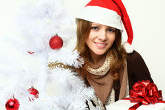 Smiling woman with Xmas tree Royalty Free Stock Image