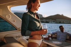 Smiling woman on yacht with friends stock photos