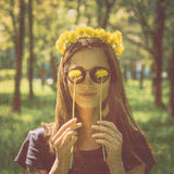 Smiling woman with yellow dandelions Royalty Free Stock Photography