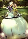 Smiling women. In a convertible car royalty free stock images