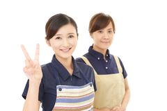 Smiling women in apron. Portrait of Asian women in apron royalty free stock photos