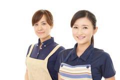 Smiling women in apron. Portrait of Asian women in apron royalty free stock photo